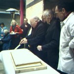 ARchbishop Conti cutting St. Alphonsus' Celebration Cake