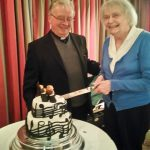 Johanna cuts the cake as Mgr. Gerry looks on