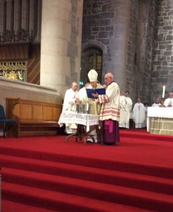 Bishop Nolan blesses the oils