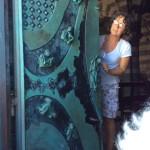 Our lovely sacristan guide, Rita, explaining the church doors