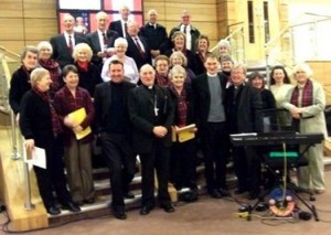 Archbishop Mario Conti, Dr Whitley and some of the St Mungo Singers at the 'Vita Kentigerni' celebration in the Mitchell Library on 12th January 2008. Photograph © Margaret St John.